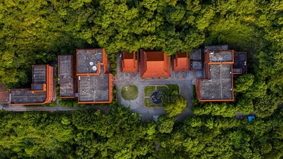 Commercial Aerial Photograph of building surrounded by trees