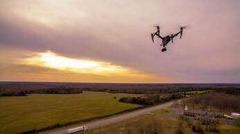 Aerial videography Sheffield photo of DJI Inspre quadcopter flying towards sunset.